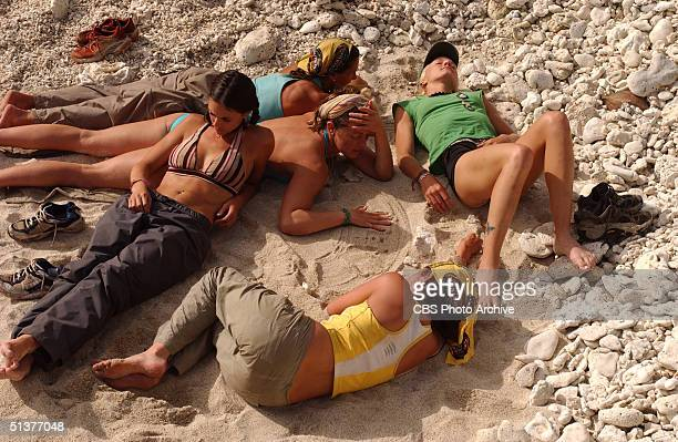 American reality tv show participants rest on a rocky beach during an episode of 'Survivor Vanuatu Islands Of Fire' Port Villa Vanuatu June 26 2004...