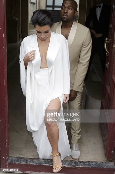 American reality TV star Kim Kardashian and American singer Kanye West leave their residence in Paris on May 23 ahead of their wedding Kanye West and...