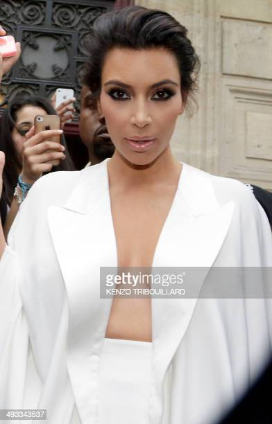 American reality TV star Kim Kardashian leaves her residence in Paris on May 23 ahead of their wedding American singer Kanye West and his bridetobe...
