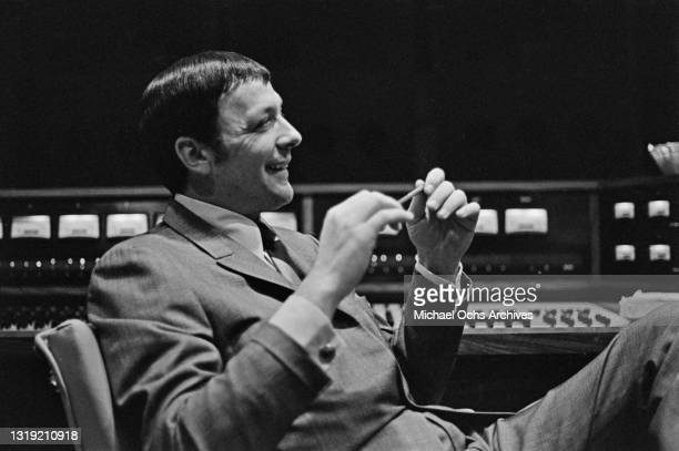 American record producer and music business executive Fred Foster sitting in a recording studio at the offices of Monument Records in Hendersonville,...