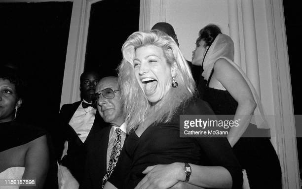 LR American record producer and music industry executive Clive Davis and Taylor Dayne at a party in July 1989 in New York City New York