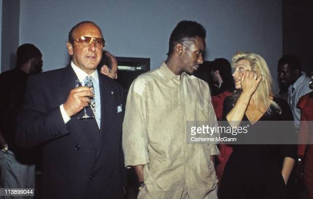 LR American record producer and music industry executive Clive Davis Bobby Brown and Taylor Dayne at a party in July 1989 in New York City New York