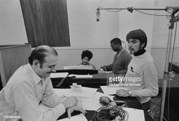 American recording engineer and producer Tom Dowd and Turkish-American music producer Arif Mardin with American singer, songwriter, pianist, and...