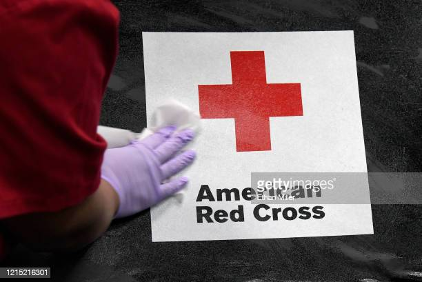 American Red Cross employee Darryl Thompson Jr sanitizes a blood bed during an American Red Cross blood drive to help alleviate a blood supply...