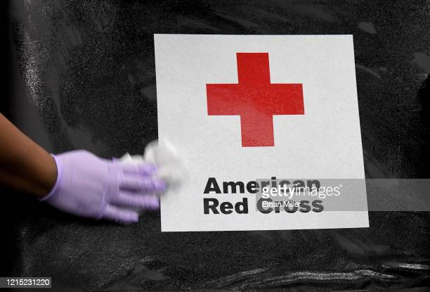 American Red Cross employee Darryl Thompson Jr. Sanitizes a blood bed during an American Red Cross blood drive to help alleviate a blood supply...