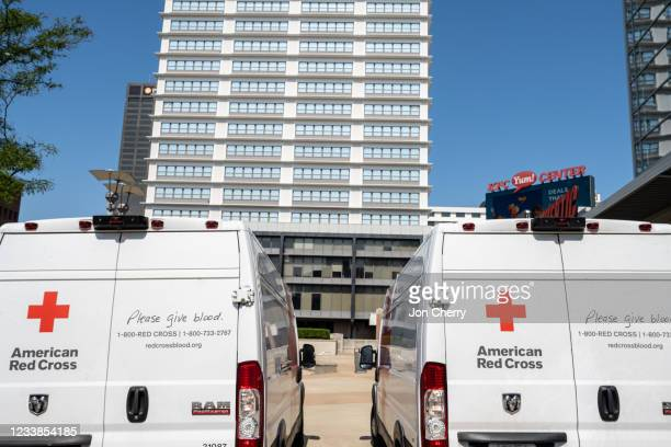 American Red Cross vehicles sit parked outside of the KFC YUM! Center during the Starts, Stripes, and Pints blood drive event on July 7, 2021 in...