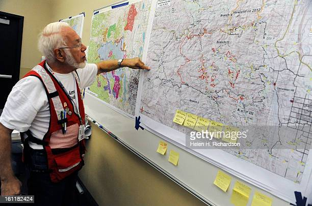 American Red Cross volunteer Roger Hoffer checks out the map of the fire at their headquarters for the High Park Fire at The Ranch today June 19th...