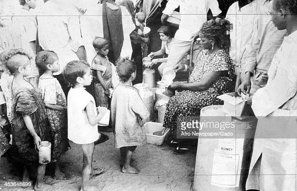American Red Cross workers distribute food aid at a refugee camp Niger 1974