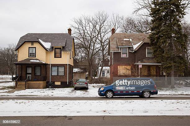 American Red Cross workers drive through Flint's north side distributing cases of water to residents on January 23 2016 in Flint Michigan Water is...