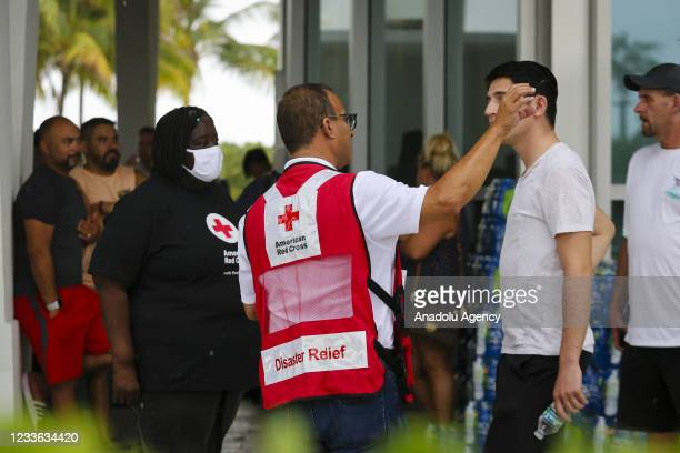 American Red Cross workers speak to people at Surfside Community Center after 12-storey Champlain Tower partially collapsed in Surfside, Florida,...