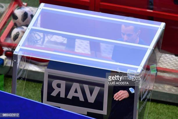 American referee Mark Geiger checks the VAR screen during the Russia 2018 World Cup Group F football match between South Korea and Germany at the...