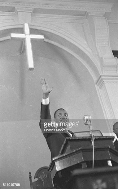 American religious and Civil Rights leader Dr Martin Luther King Jr speaks to his congregation from the pulpit at the Dexter Avenue Baptist Church...