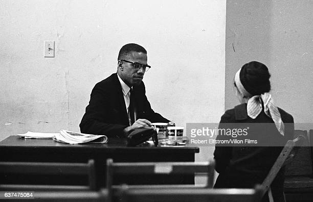 American religious and Civil Rights leader Malcolm X speaks with an unidentified woman at the Lenox Hotel Boston Massachusetts 1964