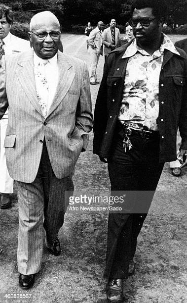 American religious leader and Civil Rights activist Reverend Martin Luther King Sr walks with Councilman Rick Taylor at a Stand Up and Be Counted Day...