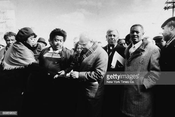 American religious leader and civil rights activist Reverrend Al Sharpton and NAACP executive director Benjamin L Hooks accept candles from lawyer...
