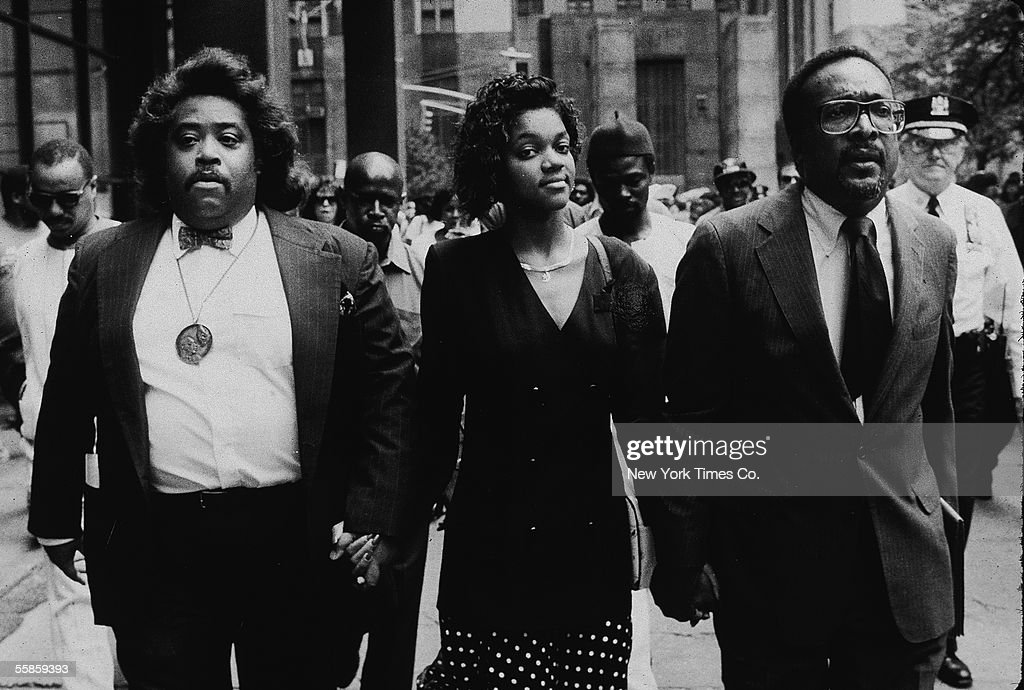 American religious leader and civil rights activist Reverrend Al Sharpton (left), Tawana Brawley, and attorney C. Vernon Mason, hold hands outside the State Supreme Court, New York, New York, July 20, 1990. The trio, at the court to attend the so-called 'Central Park Jopgger' trial, had been involved in a another high-profile rape case when, in the late 1980s, Brawley accused six men of kidnapping and rape. (Photo by New York Times Co./Getty Images) Jack Sotomayor