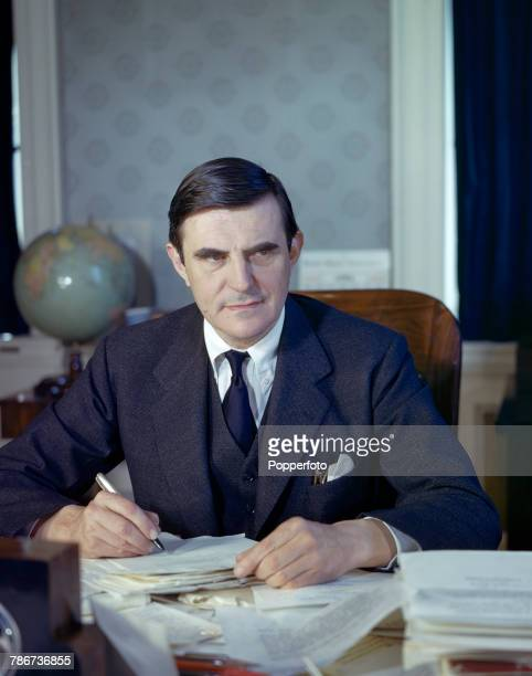 American Republican party politician and US Ambassador to the United Kingdom John Gilbert Winant pictured seated at his desk in the United States...