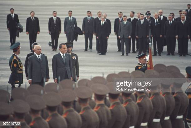 American Republican politician and 37th President of the United States Richard Nixon is greeted by Soviet government officials as he inspects a guard...