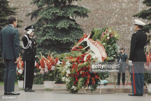 American Republican politician and 37th President of the United States, Richard Nixon , takes part in a wreath laying ceremony with military officers...