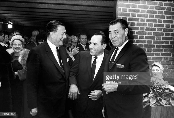 American restauranteur Bernard Toots Shor American baseball player Yogi Berra and American boxer Jack Dempsey laugh at the opening of Shor's new...