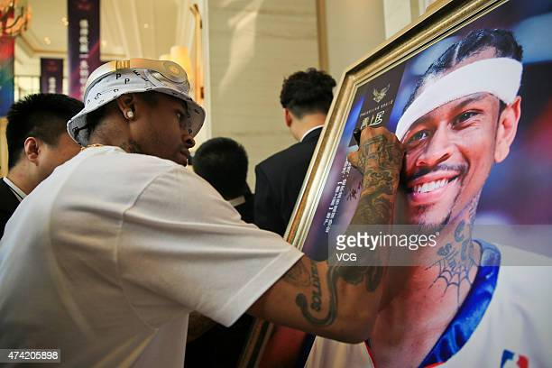 American retired professional basketball player Allen Iverson meets fans at a real estate sales office on May 21 2015 in Harbin China