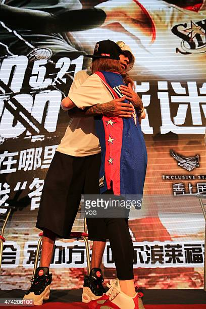 American retired professional basketball player Allen Iverson meets fans at Capitaland Plaze on May 21 2015 in Harbin China