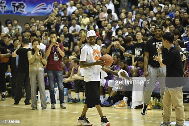 American retired professional basketball player Allen Iverson shows basketball during his visit on May 21 2015 in Harbin Heilongjiang Province of...