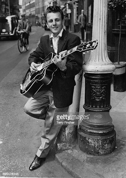 American rhythm and blues and rock roll singer Charlie Gracie strumming his guitar outside the Hippodrome London where he is rehearsing for his...