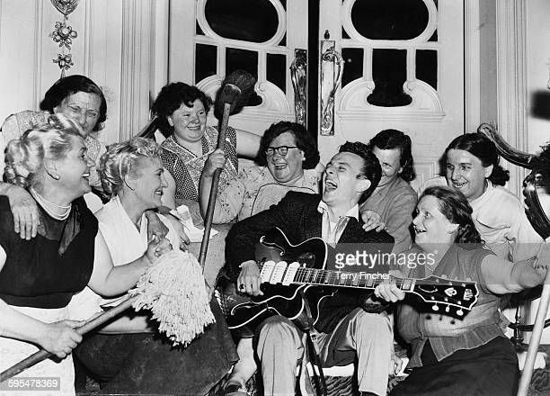 American rhythm and blues and rock roll singer Charlie Gracie entertaining the cleaning staff at the Hippodrome London where he is rehearsing for his...