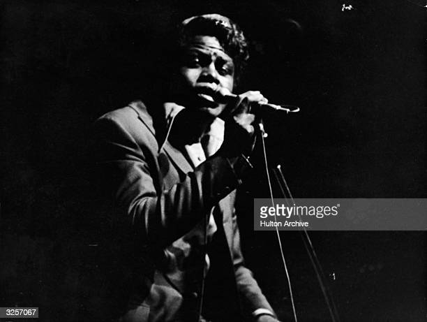 American rhythm and blues and soul singer James Brown sings on stage at the Olympia theater Paris France September 22 1967