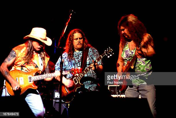American rock and blues group The Allman Brothers Band perform onstage Chicago Illinois 1990s Pictured are from left guitarists Dickey Betts and...