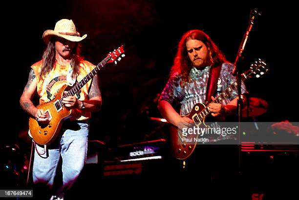 American rock and blues group The Allman Brothers Band perform onstage Chicago Illinois 1990s Pictured are guitarists Dickey Betts and Warren Hayes