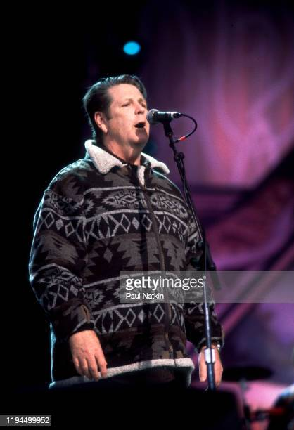 American Rock and Pop musician Brian Wilson performs onstage during the Farm Aid benefit concert iat the World Music Theater, Tinley Park, Illinois,...