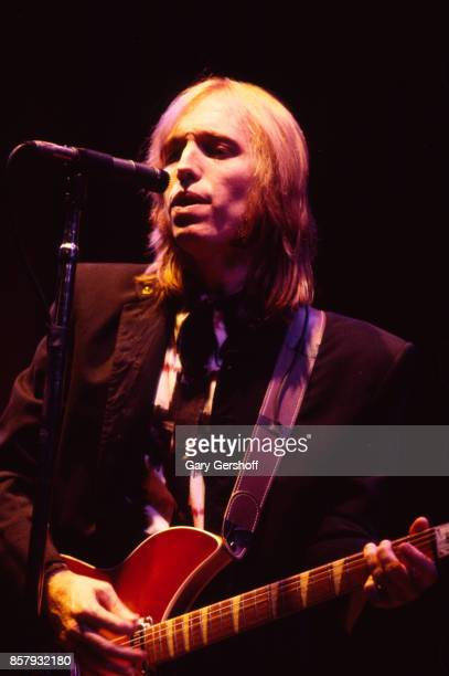 American Rock and Pop musician Tom Petty plays guitar as he leads his band the Heartbreakers during a performance on the 'Southern Accents' tour at...