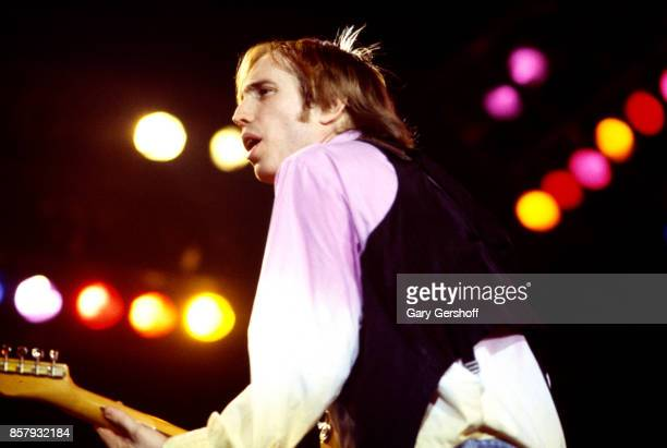 American Rock and Pop musician Tom Petty plays guitar as he leads his band the Heartbreakers during a performance on the 'Long After Dark' tour at...