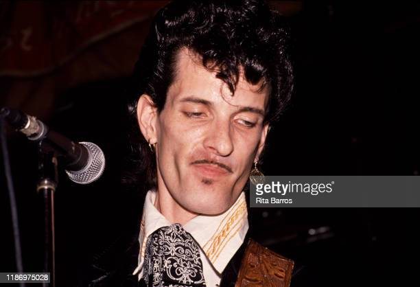 American Rock and RB musician Willy DeVille plays guitar as he performs onstage at the Lone Star Cafe nightclub New York New York May 1988