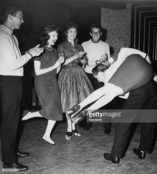 American rock and roll band The Crickets jiving in London during a threeweek tour of the UK 1958 They are Jerry Allison Buddy Holly and Joe B Mauldin