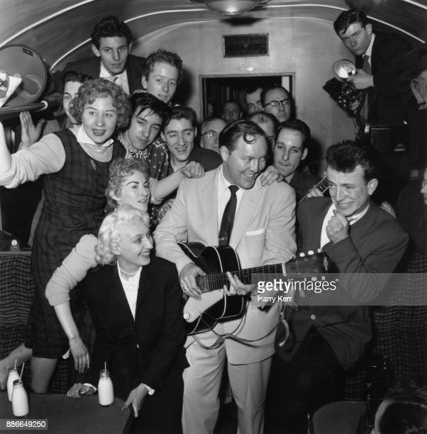 American rock and roll musician Bill Haley and his band Bill Haley His Comets entertain their fellowtravellers in a cramped railway carriage en route...
