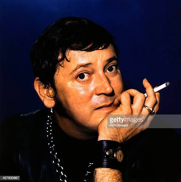 American rock and roll musician Gene Vincent posed smoking a cigarette in London circa 1970