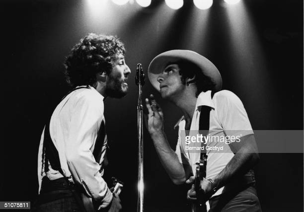 American rock and roll musicians Bruce Springsteen Steven Van Zandt harmonize togather while they perform on stage mid 1970s