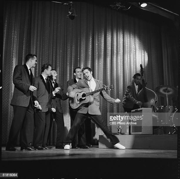 American rock and roll singer and actor Elvis Presley dances as he sings during his second appearance on the Ed Sullivan Show, New York, New York,...