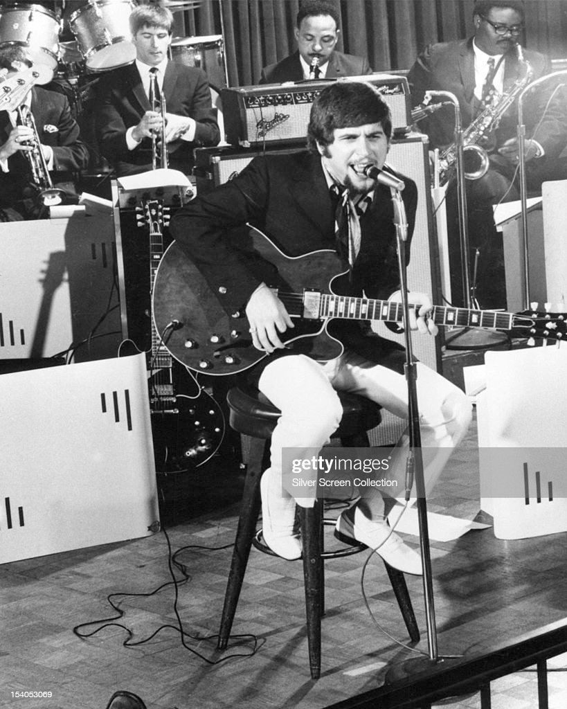 American rock and roll singer Johnny Rivers performing, circa 1965.