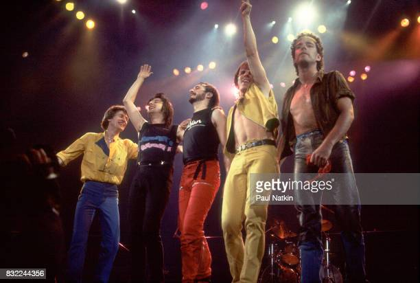 American rock band Journey left to right bassist Ross Valory singer Steve Perry drummer Steve Smith guitarist Jonathan Cain and guitarist Neal Schon...