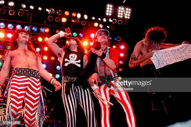 American Rock band Quiet Riot performs onstage at Reunion Arena Dallas Texas October 21 1984 Pictured are from left Carlos Cavazo Frankie Banali...