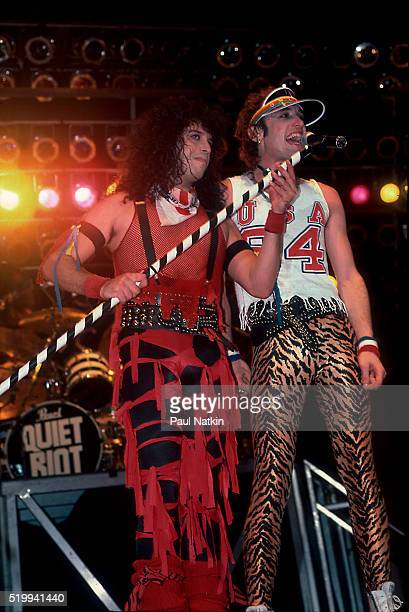 American Rock band Quiet Riot performs onstage at the UIC Pavillion Chicago Illinois November 10 1984 Pictured are from left drummer Frankie Banali...