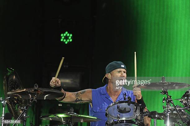 American rock band Red Hot Chili Peppers' drummer Chad Smith performs during a concert at the stadium Mateo Flores in Guatemala city on March 9 2013...
