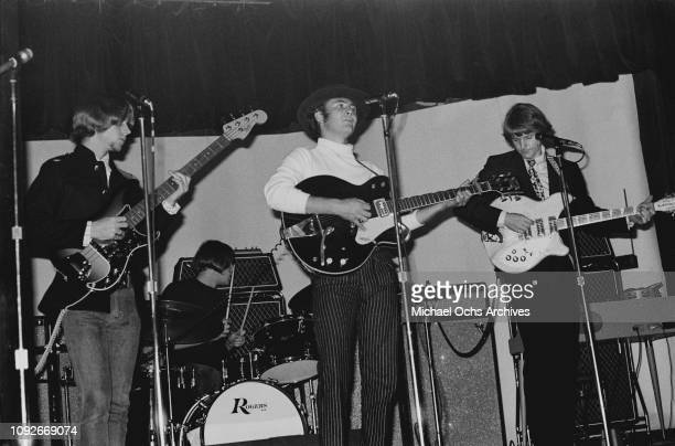 American rock band The Byrds in concert circa 1965 From left to right they are bass player Chris Hillman drummer Michael Clarke guitarist David...