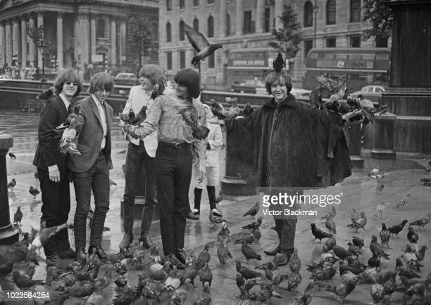 American rock band The Byrds surrounded by pigeons in Trafalgar Square London UK 3rd August 1965 they are Roger McGuinn Gene Clark David Crosby...