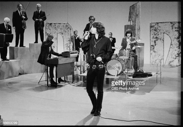 American rock band The Doors, led by singer Jim Morrison , perform on 'The Smothers Brothers Comedy Hour' backed up by other musicians, California,...
