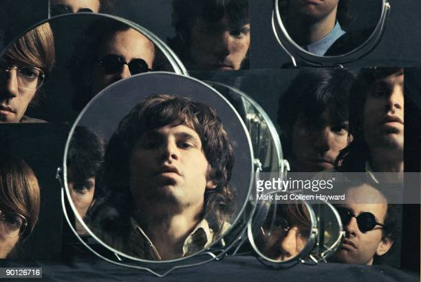 American rock band The Doors mirror their looks for a photoshoot 1967 They are vocalist Jim Morrison keyboardist Ray Manzarek drummer John Densmore...